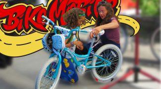 woman repairing a child's bike