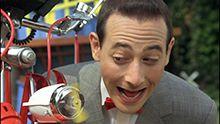 Pee Wee Herman with his bike.