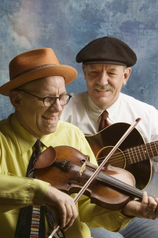 photo of the Canote Brothers with a violin and guitar