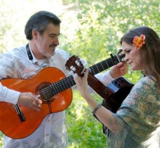 photo of Arwen and Jorge from Cascada de Flores playing instruments