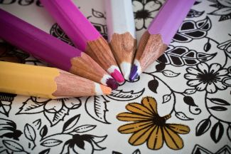 Colored pencils on a coloring sheet with a floral pattern - picture from Pixabay