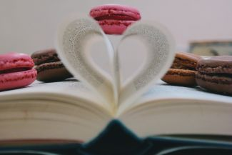 Cookies and book with pages folded into a heart