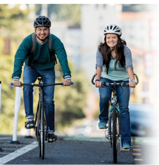 two city cyclists, smiling