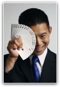 photo of magician Dan Chan doing card trick