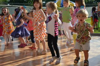 photo of kids dancing; Dancing Kids by Joe Shlabotnik is licensed under CC By-NC-SA 2.0, from flickr