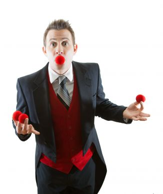 photo of magician Dante Mancini with magic ball coming out of mouth
