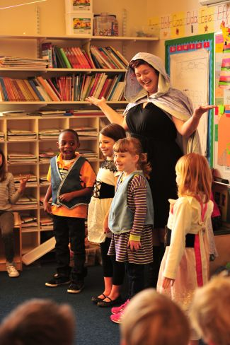 photo of children and San Francisco Opera Teaching Artist at Hansel and Gretel Sing a Story program