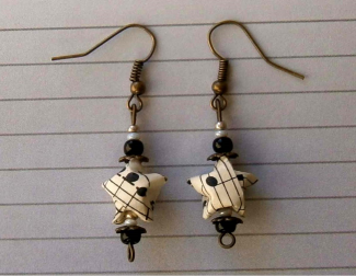 star-shaped origami earrings made from recycled paper