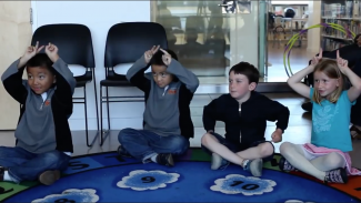 photo of kids doing hand movement; used by permission of SaveNature.org