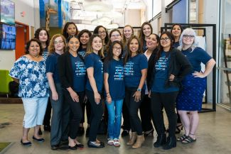 photo of women in blue and white t-shirts