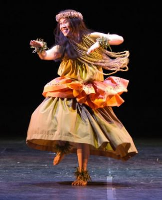photo of author, illustrator and dancer Edna Cabcabin Moran dancing hula; photo credit Lin Cariffe