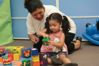 photo of child and woman playing with blocks; Terry Lorant Photography/CA State Library LSTA Grant