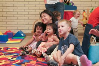 photo of children sitting with adult at Parent-Child workshop