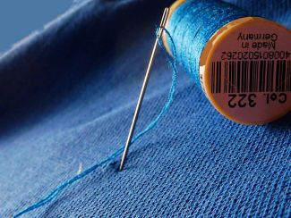needle, thread, and fabric