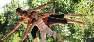 picture of three people, all different ages, tilting to one side on one foot and stretching out their arms