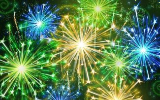 photo of yellow, blue, and green fireworks up close