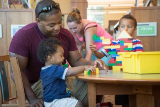 photo of children and parent playing with lego; Terry Lorant Photography/CA State Library LSTA Grant