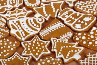 gingerbread cookies with white icing in many shapes