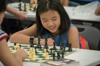 Girl learning Chess