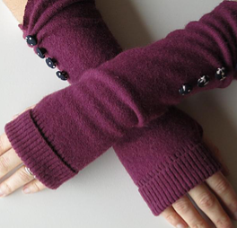 purple fingerless gloves with black buttons