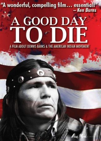 movie poster of film, featuring a young Dennis Banks against the stars and stripes.