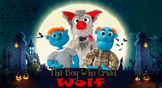 photo of puppets from Halloween version of Boy Who Cried Wolf show in front of a full moon with bats flying near their heads