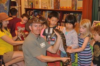 photo of Jungle James and kids holding a snake