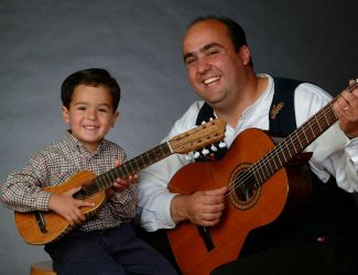 photo of Juan L. Sanchez and child with their guitars