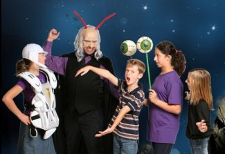photo of a group of kids in space costumes and making funny faces