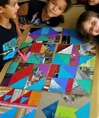 photo of kids with the quilt they created with Peopleologie