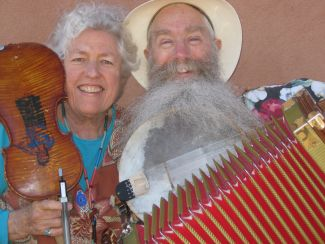 photo of Jeanie McLaren and Ken Keppeler holding various instruments