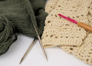 imgae of knitted and crocheted fabric with needles and hooks