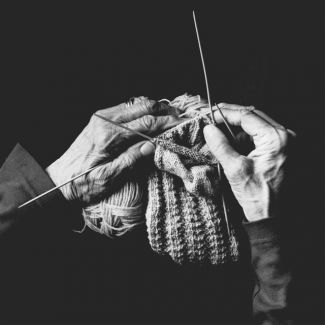 image of hands knitting