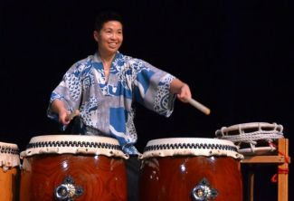 picture of Kristy Oshiro playing taiko drums; permission of Kristy Oshiro