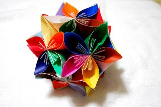 Many-colored origami kusudama flower - photo by Flickr user Quilling Xu