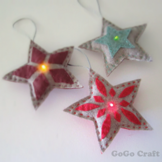 Three star-shaped light up ornaments