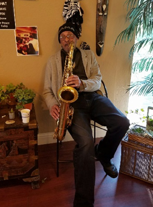 Photo of Leon Williams playing a tenor saxophone