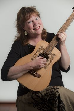 photograph of MaryLee Sunseri holding a guitar