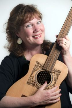 photo of Marylee Sunseri playing guitar