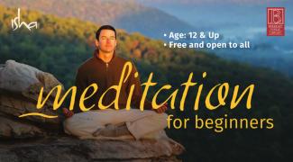 man sitting on rock meditating