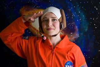 photo of actress dressed as astronaut; used by permission of Traveling Lantern Theatre
