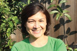 Journalist Monica Campbell in green shirt.