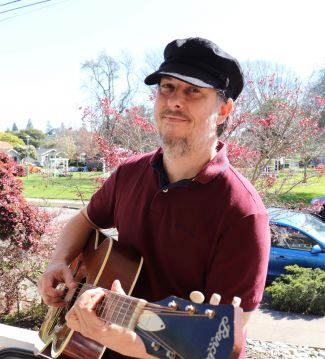 photo of musician Morgan Cochneuer holding a guitar; used by permission of Morgan Cochneuer