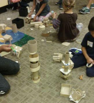 photo of kids building towers during Nature Studio program