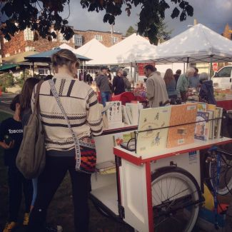 Patrons browsing at the North Berkeley Farmer's Market