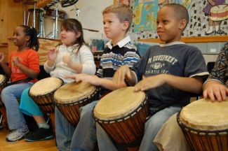 photo of seated kids playing Djembe drums; used by permission of Don O'Brien