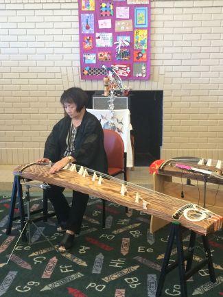 photo of Shirley Kazuyo Muramoto playing koto at Peace Day event