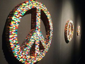 Wall-mounted peace signs made of Lego blocks