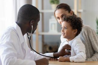 image of doctor examining child.