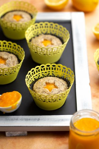 poppyseed cupcakes in yellow tins